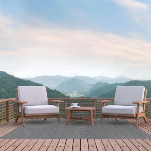 Outdoor deck with two chairs and Foss Floors area rug.