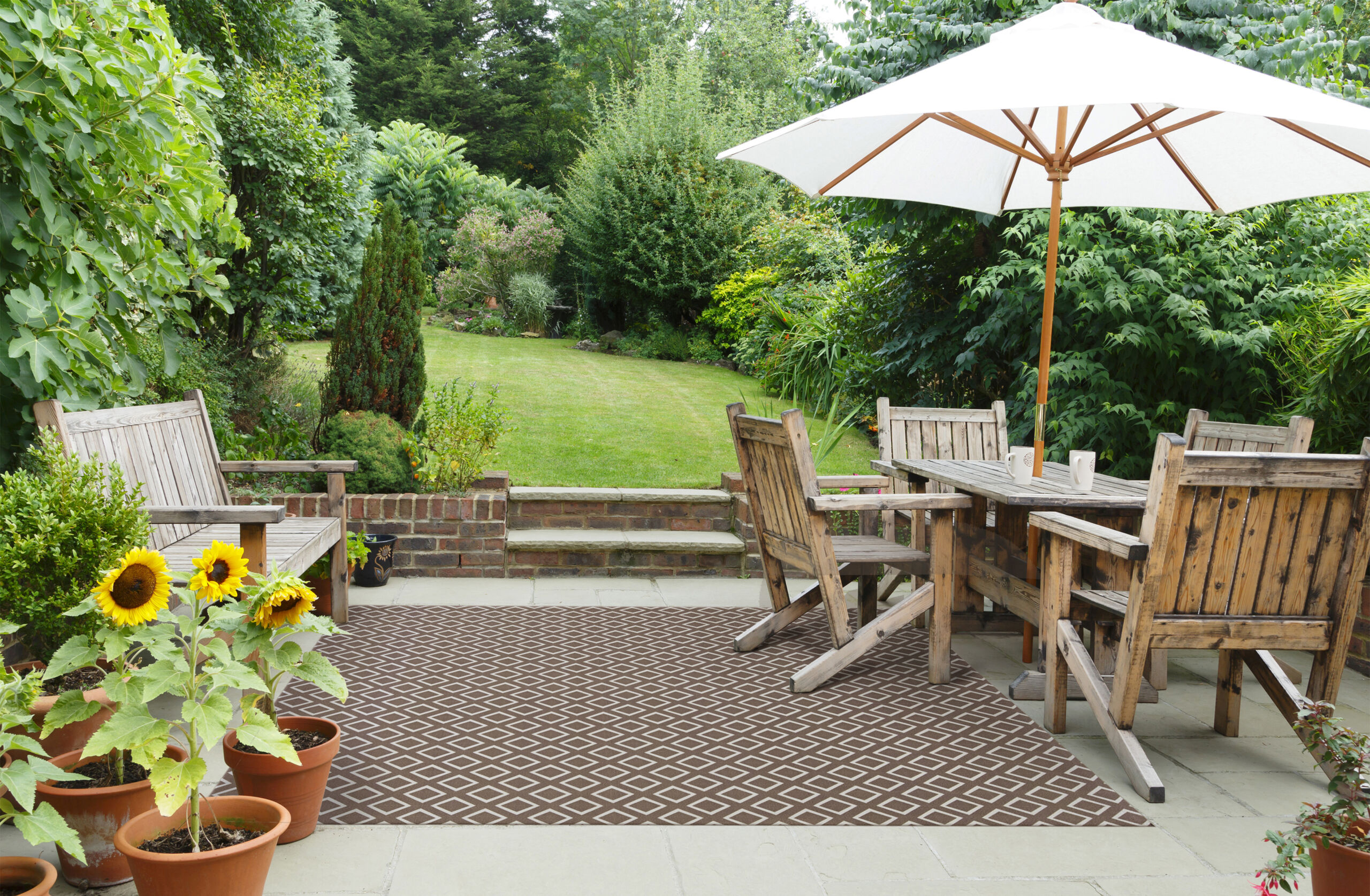 Foss Floors area rug being used in outside garden patio