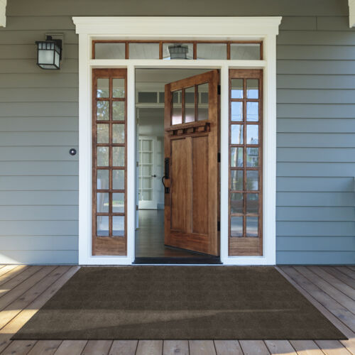 Front porch with wooden door and Foss Floors carpet in front of it.